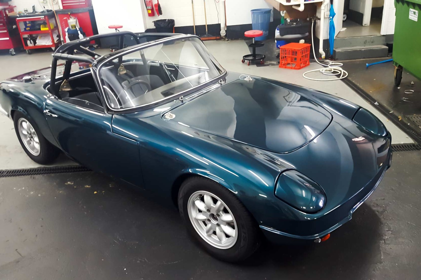 This 1964 Lotus Elan circuit racer has has the entire front end wrapped including headlights, lower fender, guards, and bonnet, to preserve its paint, and delicate fibreglass shell.